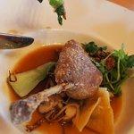 Crisp duck leg, duck dumpling, gourmet mushrooms in broth