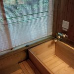 Cypress bathtub that smells lovely as it fills with hot water.