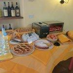 Part of breakfast buffet- eggs, toast, cakes, juice