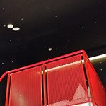 """bed with view of """"stars"""" on walls."""