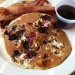 Short stack Ricotta Triple Berry Pancakes and bacon