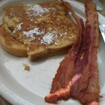 Half order of the French toast and a side of bacon