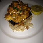 Swordfish on a bed of rice topped w/ creole sauce & crab meat.