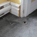Weird holes in the floor underneath window