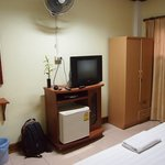 Room with TV, fan and mini fridge