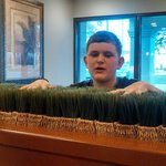 "Quality inns ""lobby grass"". Is nice and fluffy....thanks for the stay......."