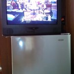 tv on fridge double's as a tv stand