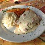 Tilapia with creamy sauce and garlic potatoes