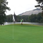 Dad putting with stone mtn. in back