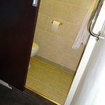 narrow toilet area with sliding door