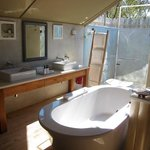 The bathroom in the tent rooms (notice the roof and outdoor shower!).