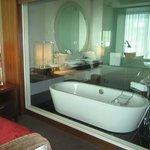 Glass wall separating enclosing bathroom