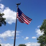 Flag above resting place.