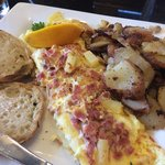 Hawaiian omelette with home fries and English muffin.
