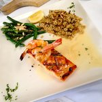 Grilled Salmon with two shrimps, green beans and brown rice.