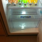 The fridge with drinks that nobody wants...any with  no labels out so you have no idea what they