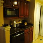 Kitchenette area. Includes mini fridge, microwave, dish sets and glasses.