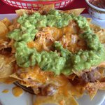 Nachos with guacamole, refried beans and chicken