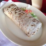 Bean and cheese burrito. Possibly made with a fresh flour tortilla