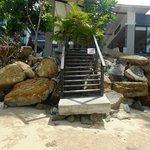 Wave damaged steps to beach.