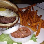 50/50 burger with fried egg and sweet potato fries... Delicious!