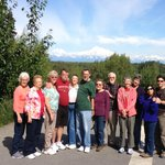 Tour group with a spectacular view of Mt. McKinley in the background.