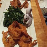 Romano cheese battered shrimp, sauteed spinach and sweet potato fries