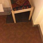 mismatched carpet in cottage room