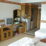 Twin beds, TV, Wardrobe with safe, Tea & Coffee facilities.