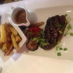 Steak with peppercorn sauce and hand-cut chips