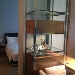 A bedroom is separated from the working area, minibar.