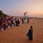 Poruwa ceremony on the beach against the backdrop of setting sun