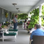Jack chatting with guests at breakfast on the porch