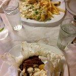Pesce con riso e patate e agnello stufato