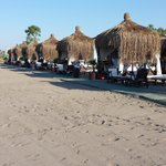 beach with sultan huts