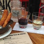 Deep fried pickles and wine float