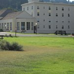 Mammoth Hot Springs Hotel with resident elk roaming around.