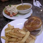 Homemade vegetable soup with ground beef, tuna salad in tomato, burger and fries
