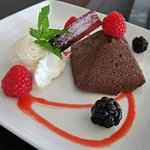 Chocolate Pâté with fresh whipped cream and berry coulis