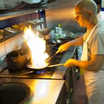 Tandoori chef in the flame light
