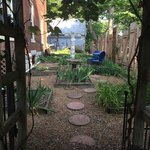 A garden in the side yard. Stepping stones lead through a seating area, outdoor patio area, and