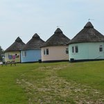 The single roundhouses looking over the sea