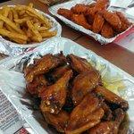 Teriyaki Curry Coconut wings, fries, and Garlic Buffalo wings