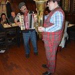 Musicians playing tuba and accordion
