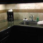 Granite counter tops/coffee maker/Stainless steel sink