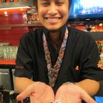 Hard Rock bartender Chatchai with homemade harley