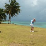 Golfing at Caye Chapel