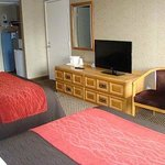 In room amenities ironing board and iron flat screen tv