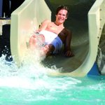 go on the slide at the hot pools
