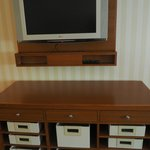 "32"" Flat screen TV and storage baskets"